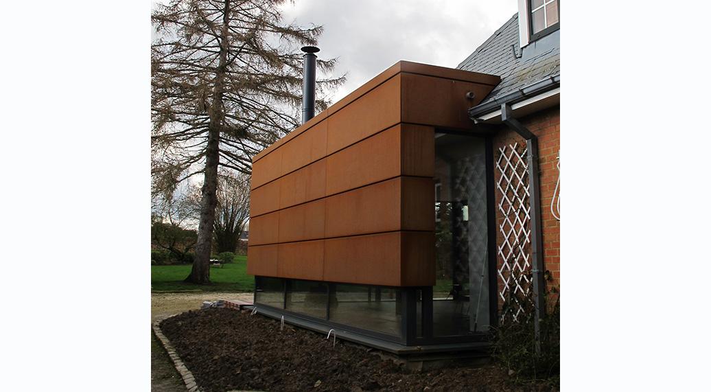 Extension en acier corten à Mons | dune Architecture, architecte ...